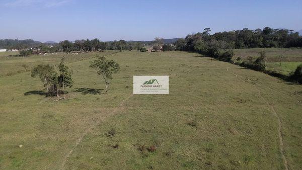 Ampla área rural com 96.160,00 m², localizada na Estrada da Ilha frente para o asfalto